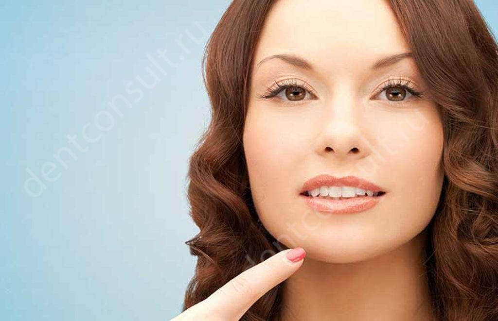 Имплантация зубов у женщин